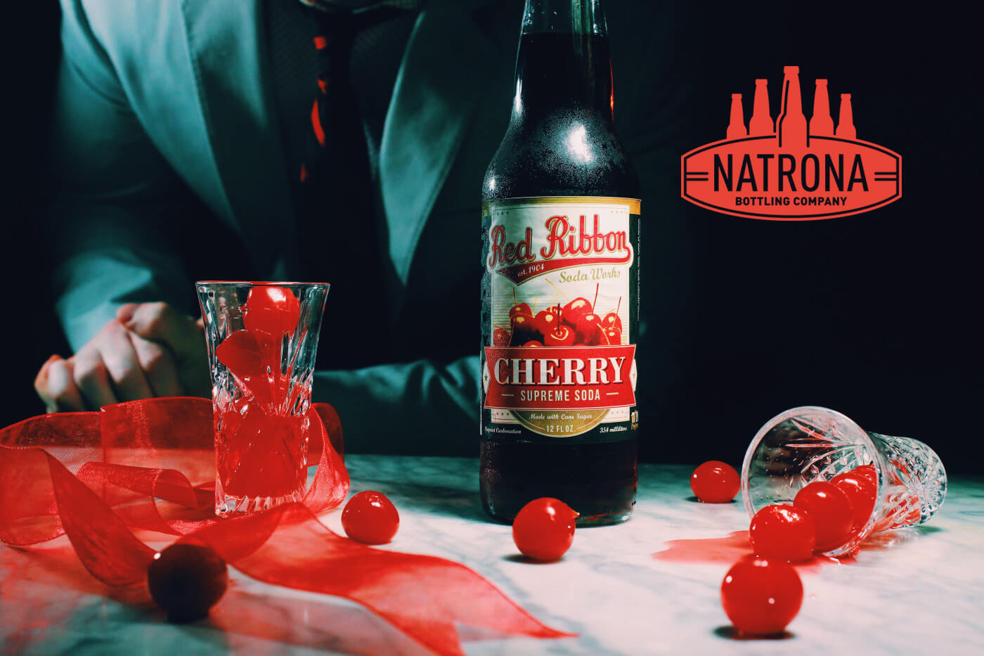 Natrona Bottling BOOM Creative Red Ribbon Soda
